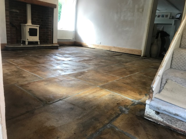 Yorkshire Flagstone Floor Covered in Bitumen After Renovation