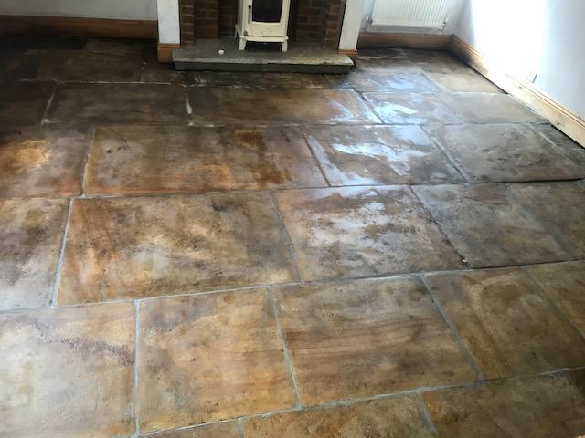 Yorkshire Flagstone Floor Covered in Bitumen After Renovation