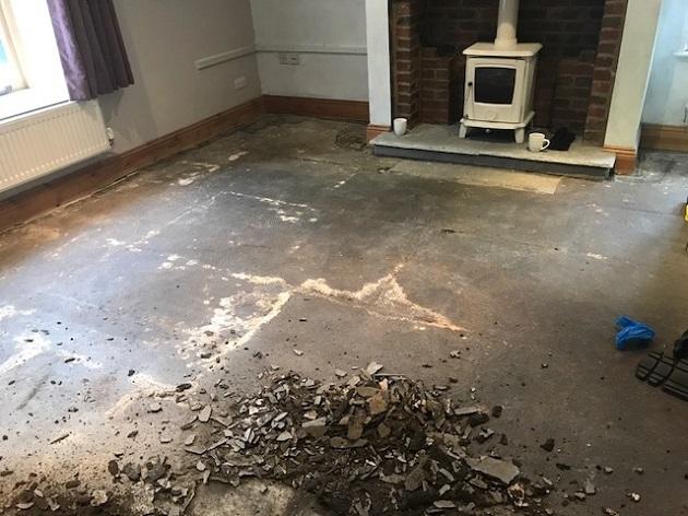 Yorkshire Flagstone Floor Covered in Bitumen Before Renovation