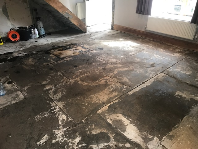 Yorkshire Flagstone Floor Covered in Bitumen Before Renovation