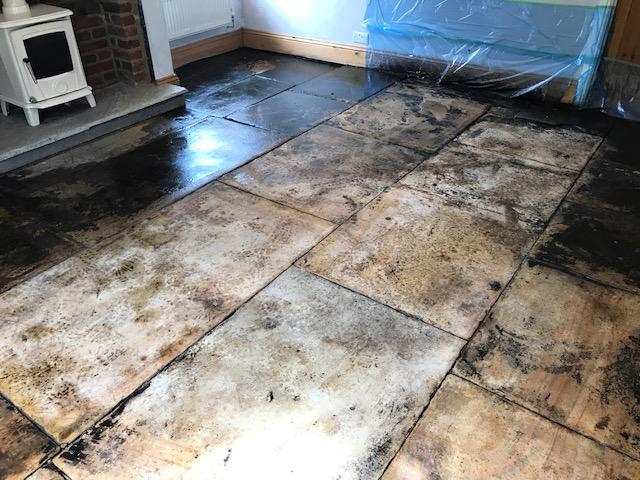 Yorkshire Flagstone Floor Covered in Bitumen During Renovation